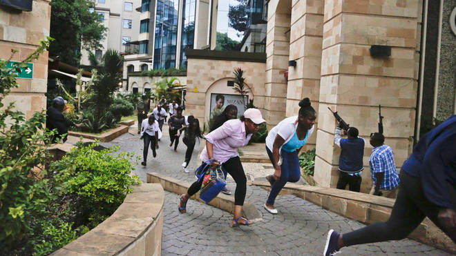 People flee the DusitD2 hotel complex during the January 15 attack