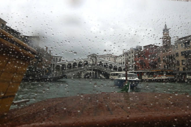 The Rialto bridge is seen from a taxi boat in Venice