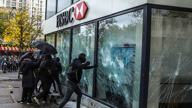 Protesters smashed a bank in the south of Paris