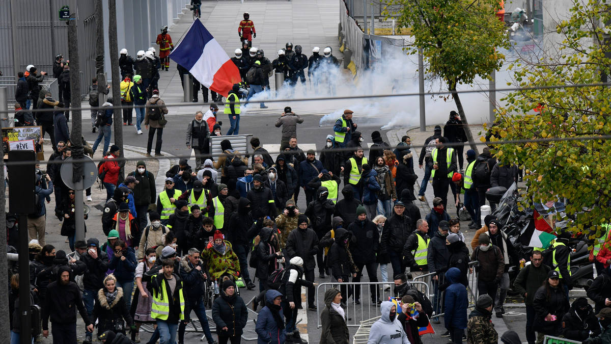 Protests erupt in Paris on anniversary of anti-government gilets jaunes movement - LBC