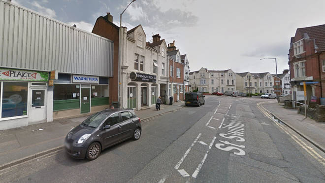 The man was found outside Bournemouth Pizza Co on St Swithuns Road
