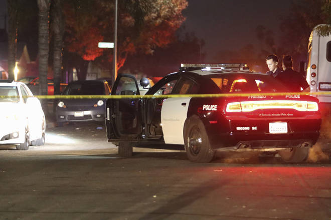 Police work at the scene of a shooting in southeast Fresno, California