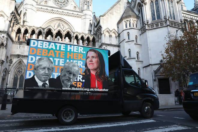 An advertising van showing Boris Johnson, Jeremy Corbyn and Jo Swinson.