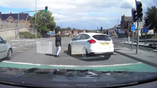 Two pedestrians narrowly avoided being hit at the crossing