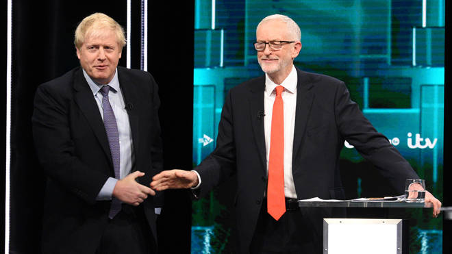 Mr Johnson and Mr Corbyn shake hands during the debate