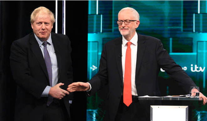 Mr Johnson and Mr Corbyn shake hands during the debate.