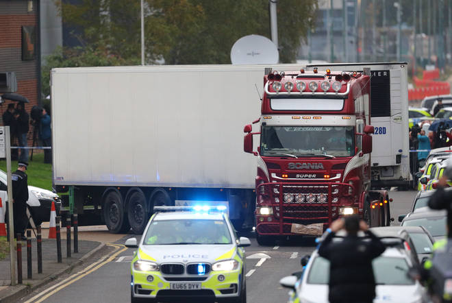 The container lorry, in which 39 people were found dead inside being driven away under escort from Waterglade Industrial Park in Grays, Essex.