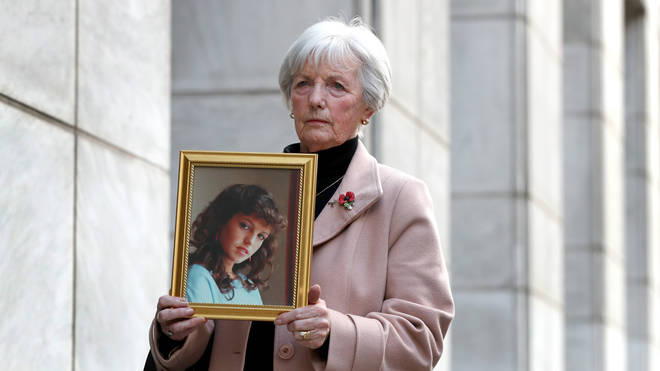 Marie McCourt holding a photo of daughter Helen
