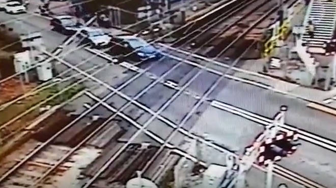 Learner driver crashes through barrier on level crossing.