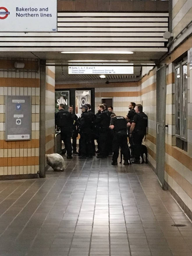 Police gathered in the entrance to the Underground at Charing Cross Station