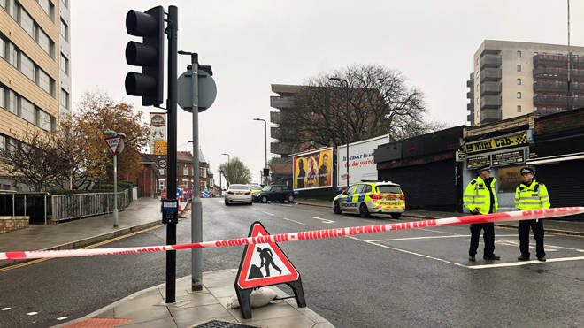 Police at the scene of a fatal stabbing in Ealing