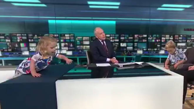 Toddler climbs on the desk live on ITV News