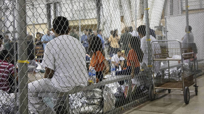 Children locked in cages while their parents are taken away in the United States.
