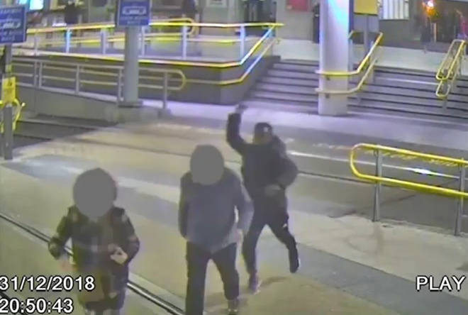 Handout grab taken from CCTV issued by Greater Manchester Police of Mahdi Mohamud attacking James Knox at Manchester Victoria railway station last New Year's Eve.
