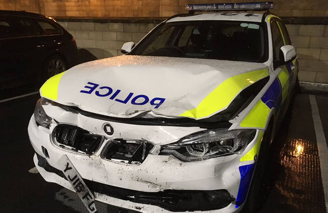A police car was badly damaged.